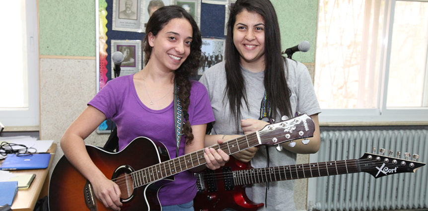 Image of JAIS high school girls with guitars