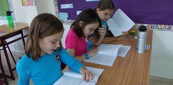 Image of three girls reading at JAIS