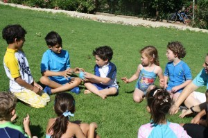 Photo of kids playing with water balloon in JAIS summer camp