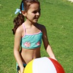 Photo of girl in JAIS summer camp playing with a beach ball
