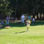 Photo of kids running on the grass hill at JAIS summer camp
