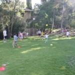 Photo of group of kids playing on the hill during JAIS summer camp