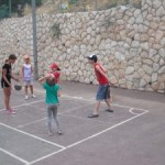 Photo of five kids playing basketball at JAIS summer camp