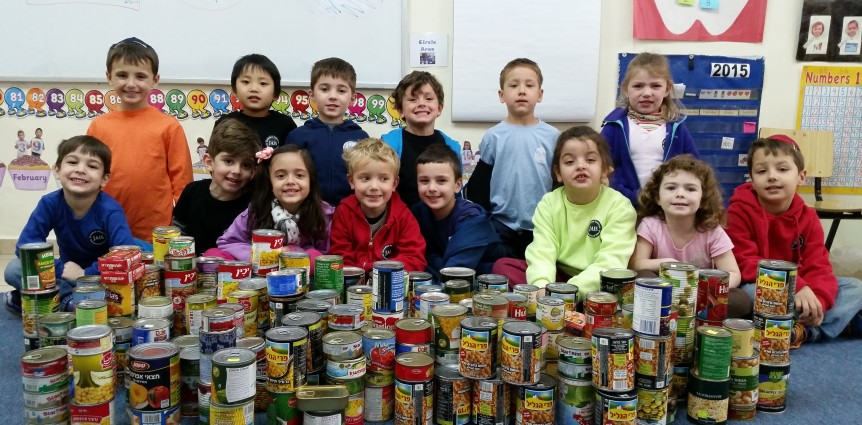 Image of children with cans for food drive.